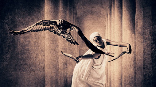 image of girl dancing and releasing a hawk in flight